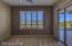 Master Suite retreat/office space/home gym with Plantation shutters new carpeting ceiling fan and sliders to the back covered patio.