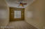 Located off the kitchen side of the home is a second bedroom that would be perfect for guests. Ceiling fan with light, Plantation shutters new carpet