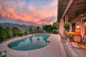 "Twilight time and life is good on your private backyard. Have a barbeque or a ""happy hour"" watching the incredible sunsets reflected off the mountains."