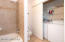 Full size washer and dryer in bathroom closet.