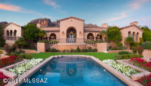 Feel like you have escaped to an Old World Villa with the Ambience of Tuscany. Beautiful Pool and Mature Landscaping includes Citrus Trees, Various Hybrid Tea Roses, Large Golden Barrels, Cascading Bougainvillea, Perrienial and Annual Flowers along with High Grade Turf.