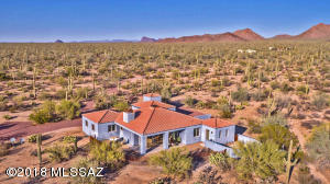 Enjoy the serenity of this custom-desert retreat. Situated on 8 lush saguaro-studded acres.