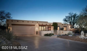 Enter this beautiful custom Arena home through the lovely courtyard.