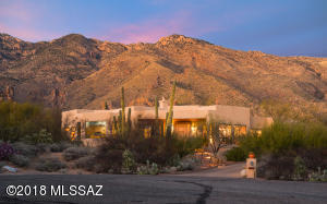 Set at the end of a cul-de-sac in highly desirable Alta Vista Estates, minutes from World Class Golf Resort and Country Club at Ventana Canyon this soft contemporary home is 3575 Square feet with 4 Bedrooms, 3.5 baths and resort style back yard.