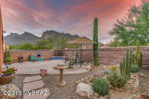 Gorgeous Backyard Featuring: Large Flagstone Patio, Bunco Seating, Custom Copper Water Fountain & Beautiful Low-Care Desert Landscaping