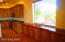 Kitchen with Custom Window and custom cabinets