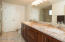 Dual vanity with executive-height counters, soft-close cabinets, granite counters. Walk-in shower with granite surround.
