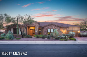 All the bells & whistles. Stunning 3BR/3½BA+den former model in gated 14 home community next to Golf Club at Vistoso & Stone Canyon Golf Club.