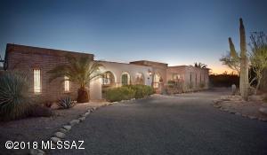 Beautiful custom-built home on premium acre-plus lot.