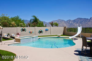 Welcome summer in style in a resort style backyard, wonderful privacy on this premium view .27 acres view lot.