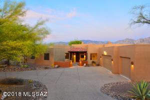 Front of home w/ Catalina Mtns in the rear