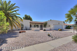 Super home with 2 bedrm/2bath great room, living room/dining area, kitchen with eat-in nook, laundry room with storage, 2 car garage separate storage closet, GREAT east patio w/views of golf course and mountains