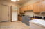 Laundry room w/utility sink & cabinets for storage