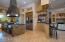Spacious kitchen w/granite counters & stainless steel appliances