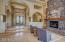 Grand! Decorative glass & solid wood double door entry leads over natural stone floors, through arched entry, and into lovely great room and sitting area with stacked stone gasfireplace.
