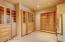 Huge walk-in closet w/built-in shelving & drawers