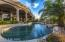 Gorgeous pool, waterfall feature, spa, luscious palms and huge covered patio.