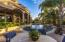 Patio space with shade from the palms is the perfect spot to dine pool side