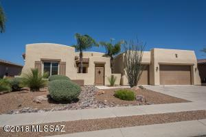 This Santa Fe style home has a fabulous 4BR, 2Den 3Bth open floorplan with 10ft ceilings inside and a tile roof on outside. It is on a dead end street with mountain views front and back and .22 acre lot