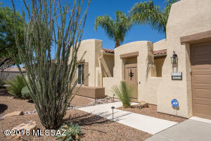 Welcoming front courtyard offers complete privacy and an inviting way to come home