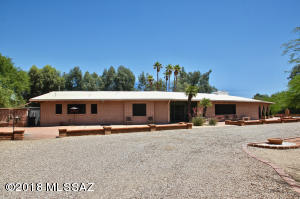 This classic burnt adobe ranch home is the ideal N/S orientation and has a large circular driveway.