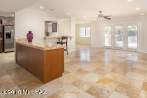 Imagine stepping into this glorious open great room. Note the Travertine