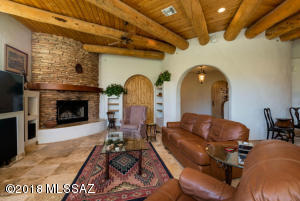 Beautify Stone Fireplace With Seating Space and Mantel