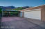 Gorgeous mountain views behind 2 Car Carport & 3 Car Garage! Half bath attached to garage! Additional storage room!