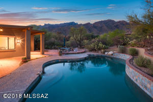 Located in the Coronado Foothills Estates at the top of the Catalina Foothills providing up-close mountain views from this resort-like backyard