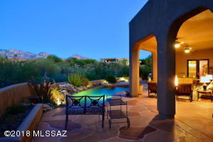 """This is a very spacious shady east-facing patio - plenty of room for a 2nd """"living room"""" and """"dining room"""" while enjoying the view, the pool, natural desert (and its inhabitants) with fans overhead. This is truly an """"end-of-day retreat""""."""