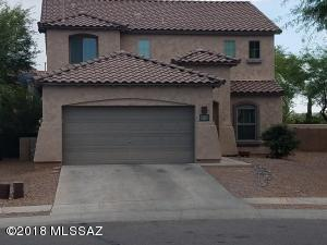 SPACIOUS 5 BR HOME WITH TILE ROOF, LOTS OF WINDOWS, AND EXTENDED GARAGE.