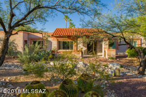 Located on a .67 acre corner lot