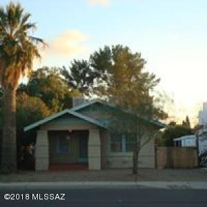 836 sq ft 2 bed home with fenced yard and parking within fenced yard.