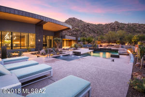Distinctive contemporary craftsmanship in prestigious Stone Canyon presents a finely tuned balance between scale & area, open & light spaces, form & architecture