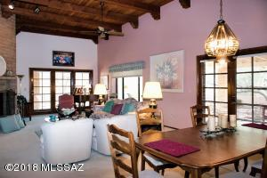 Beautiful high beamed ceiling and attractive French doors.
