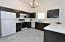 Contemporary, inviting kitchen with diagonal set ceramic tile, and dark stained cabinetry