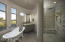 Custom designed shower, soaking tub and his & hers vanities