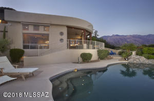 Gaze at the mountains or city lights from the porch or pool!