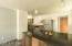 Wonderful kitchen island/breakfast bar w/ cabinets underneath!