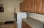 Large laundry room with cabinets and counter space