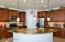 Beautiful kitchen features grantite slab countertops