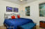 Guest bedroom easily accommodates a king bed
