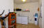 Oversized laundry room leads to garage