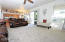Great room opens to the kitchen and backyard patio/ pool area