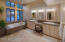 The spa-like master bathroom has slate accents, dual sinks and framed mirrors.