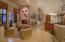 Wood floors grace the kitchen and kiva areas.