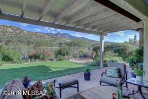 Extended covered brick patio/Ramada looks out to magnificent desert and mountain vistas.