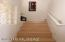 Stairs to loft family room area and 2 bedrooms upstairs