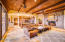 Great Room with Beamed Ceiling and Dramatic Stone Fireplace
