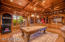 Wood Paneled Walls and Ceilings. Custom Built-in Cabinets and Bar.